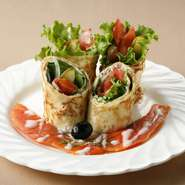 Crepe rolls with smoked salmon