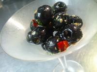 - Olive nere condite piccanti al'aglio -