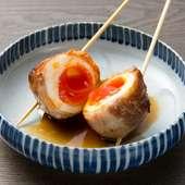 地元のうまい卵・蘭王を使った「半熟玉トロ豚焼き串」