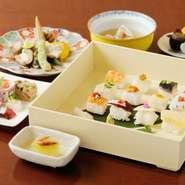 旬魚を使った料理が中心の少しリッチなランチコース。鱧や目板鰈、水ナスを使った姫寿司に北海道産トウモロコシの焼物や瀬戸内産鱸の塩焼きなど盛りだくさんです。季節・仕入れ状況で野菜の種類は異なります。