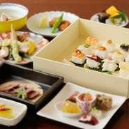 ランチながら旬の魚介料理をメインに据えた豪華なコース。自家製イカ団子や桜エビ、新蓮根のかき揚げなど一口サイズの揚物、一口ステーキなど盛りだくさんです。季節・仕入れ状況で野菜の種類は異なります。