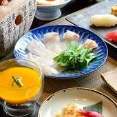 ガラス張りのカウンター席から見える広島の夜景も御馳走のひとつ