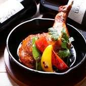 口中に肉汁溢れる『大山鶏のタンドリーチキン』