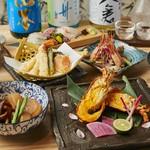 お刺身5種盛り合わせや真鯛の唐揚げ、鯛とキノコのバターホイル焼き、鯛と大根の煮物などまさに鯛づくし!