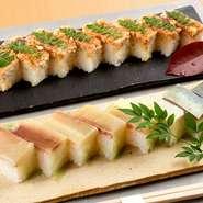 姿の「核」となる料理の1つ『押し寿司』。白板昆布で〆たサバ、サワラ、それぞれの味わいを活かした名物料理です。酒のつまみとしても、食事としても根強い人気がある定番。脂乗りが良く、味わい深さも格別です。